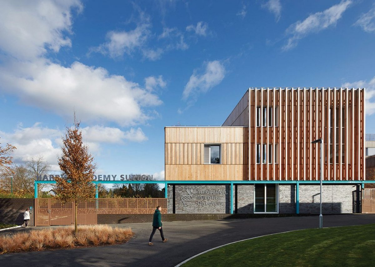 Douglas fir fins, bricks, copper cladding and aluminium windows make up the formal language of the school.