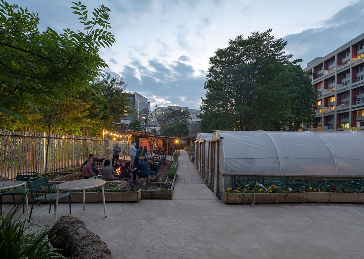 Evening event on the farm sandwiched between railway lines and flats. MacEwen Award shortlisted Waterloo City Farm, Lambeth, London by Feilden Fowles Architects. Peter Cook