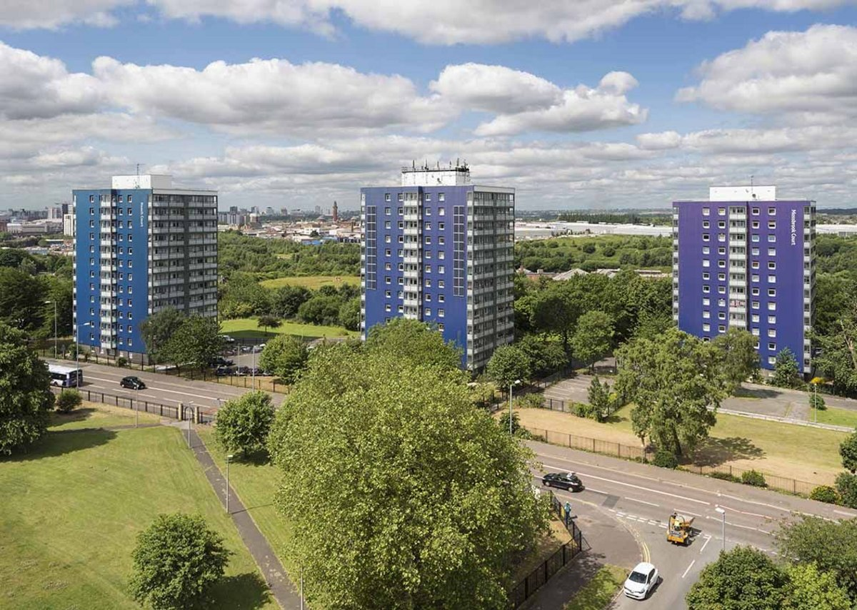 View of three of the refurbished tower blocks with their colourful facades