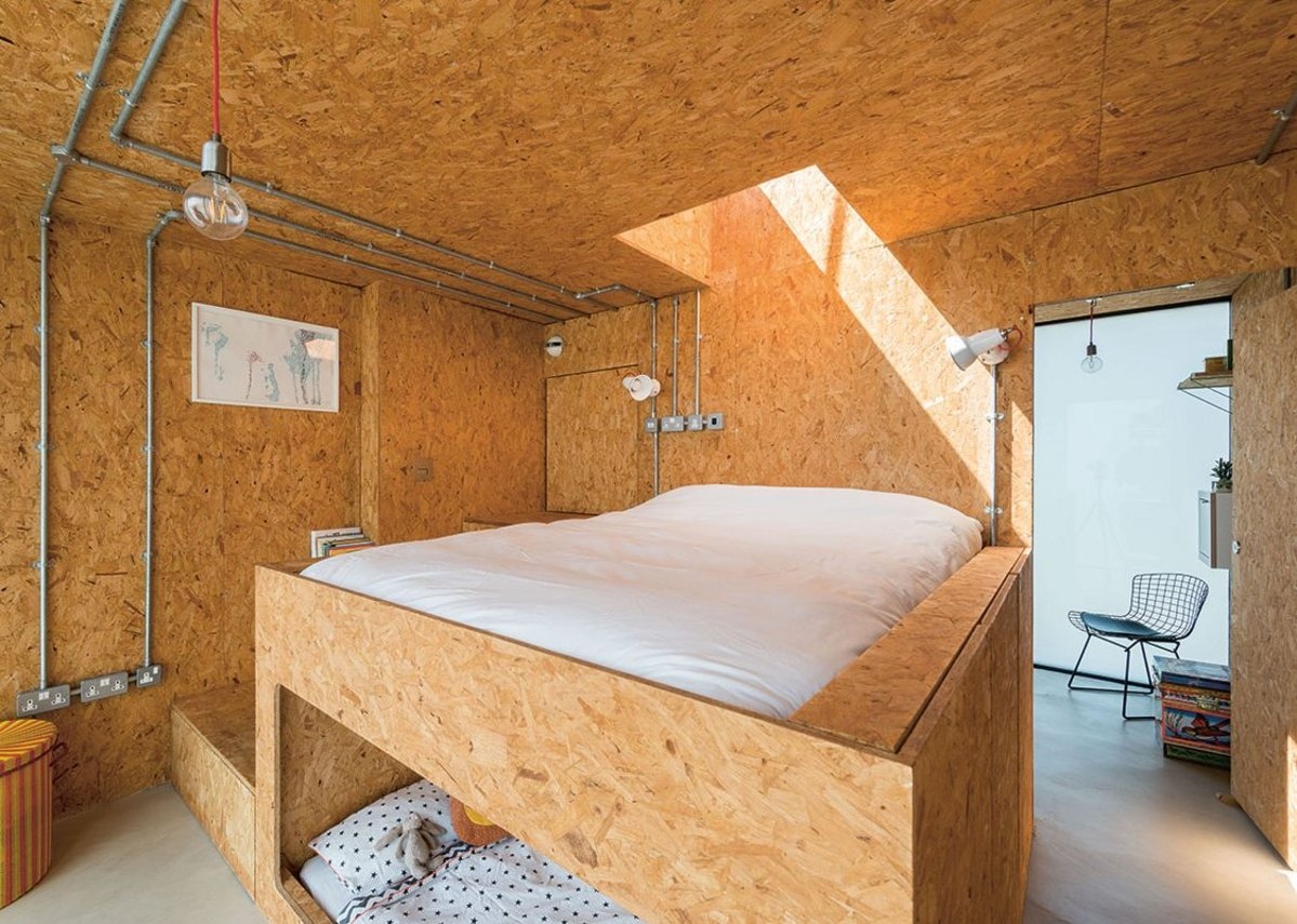 The upper level bedroom space, completely lined in SterlingOSB Zero, also has the main bed frame and children's nook built from the material.