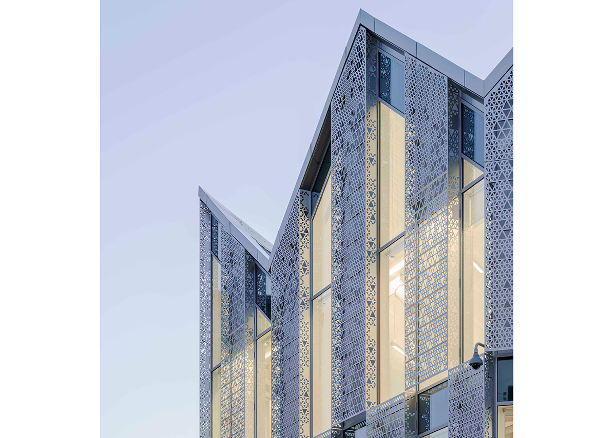 Handyside Street by Coffey Architects. Detail showing the use of perforated aluminium screens to filter the light and add depth to the façade. Photo © Tim Soar.