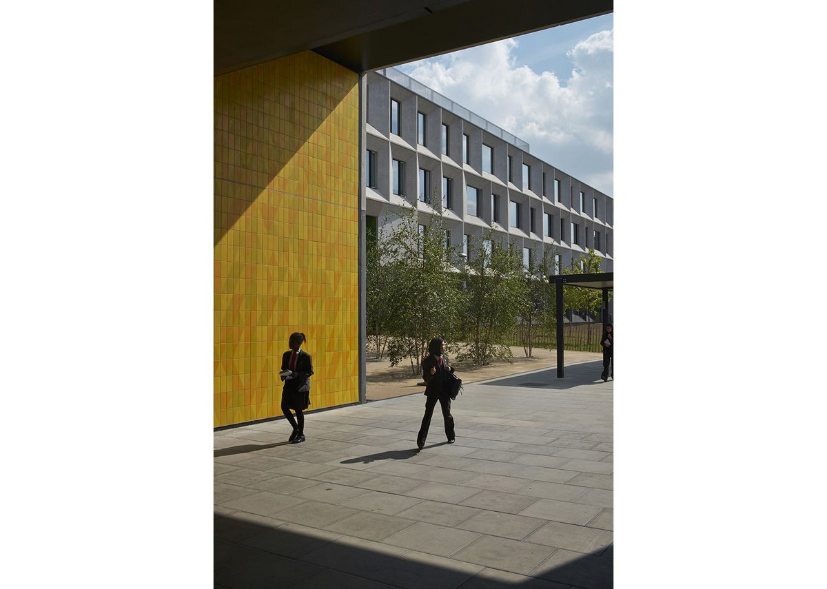 Modular facade system in the background and coloured tiles in the foreground paid for from a separate school budget.