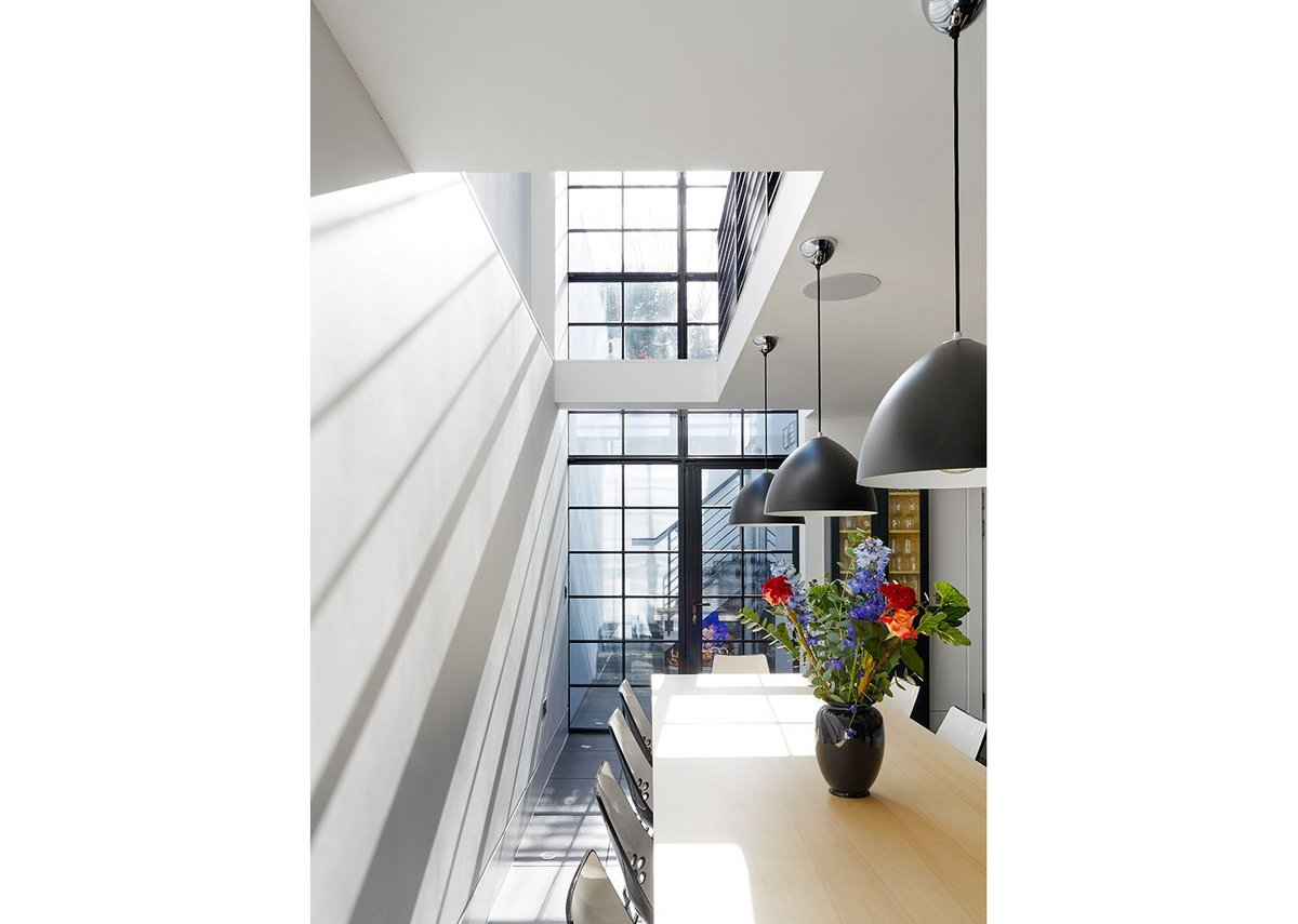 Clement steel screen maximising light over two floors for Granit Architects