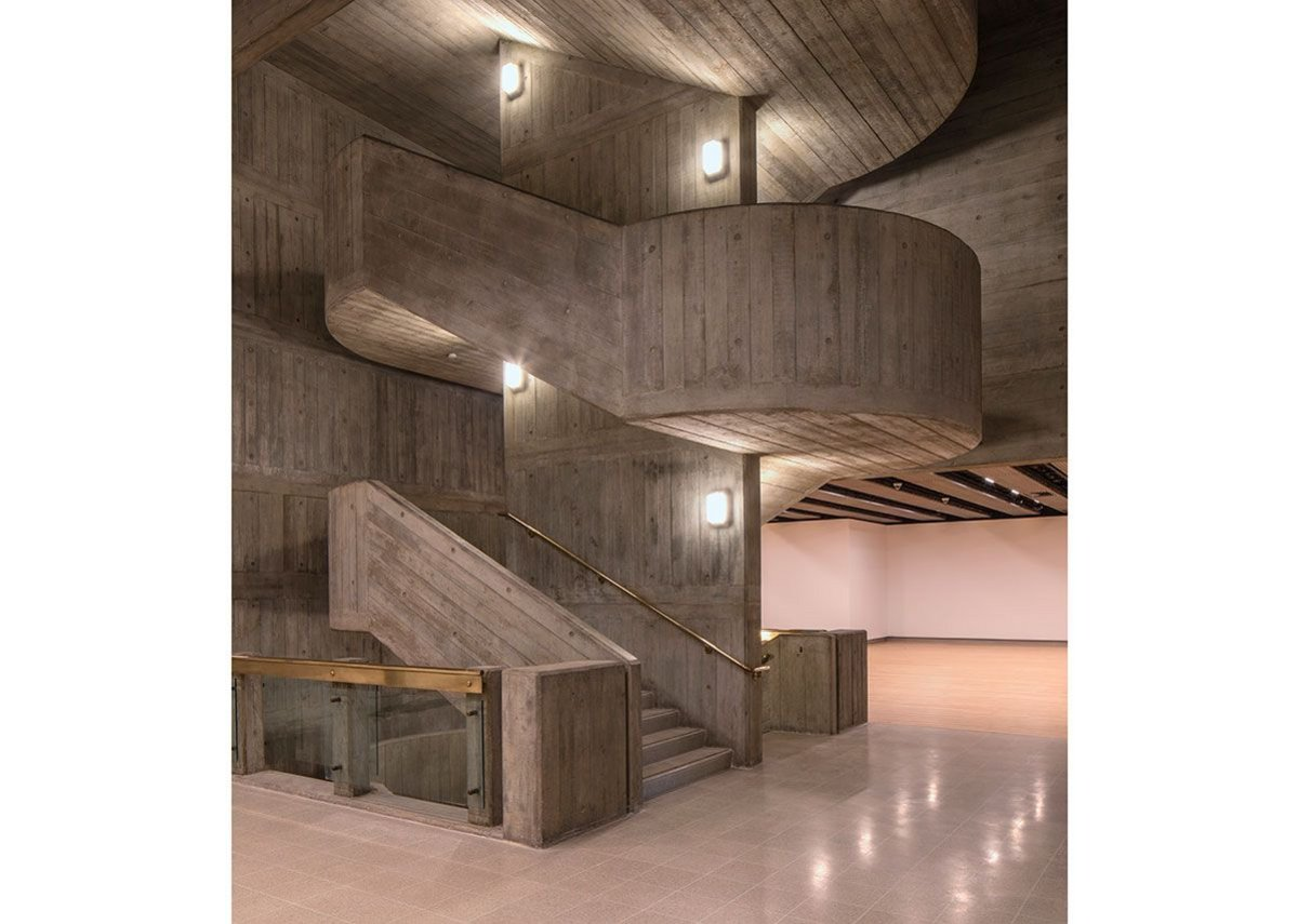 The Hayward Gallery's refurbished concrete stair, with new terrazzo floor and refinished original maple flooring beyond.