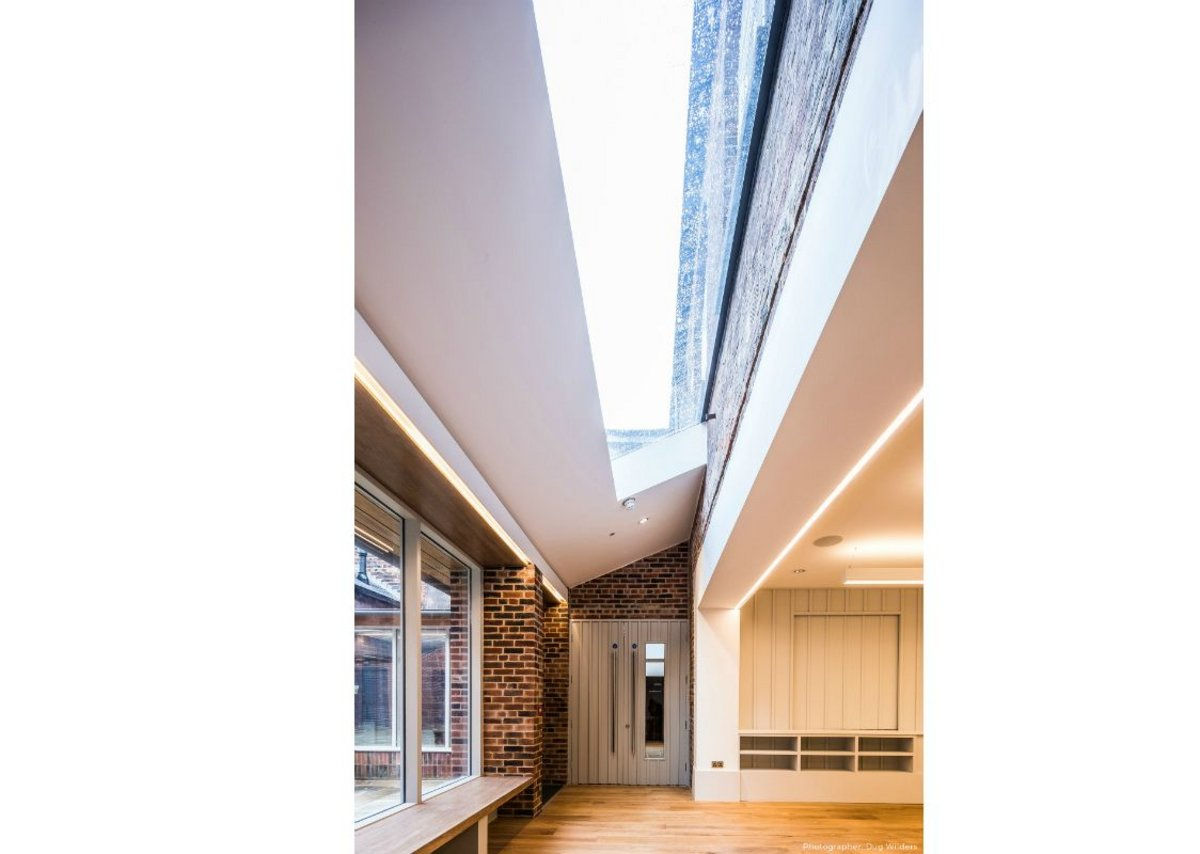 Glazing Vision's Flushglaze rooflight creates a cloistered feel along a run of corridor.