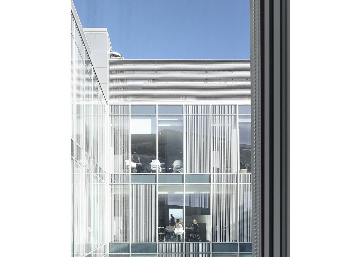 Opaque and fritted screening to the internal courtyard glazed panels helps prevent solar gain.