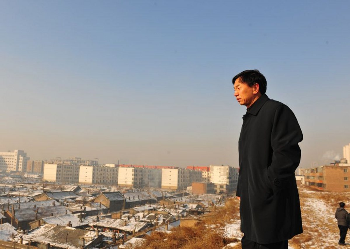 Geng Yanbo looks out over his city in a still from The Chinese Mayor.