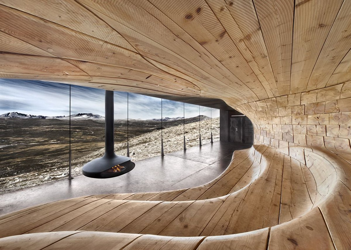 A Gyrofocus fireplace at Snøhetta architects' Norwegian Wild Reindeer Centre Pavilion in Hjerkinn.