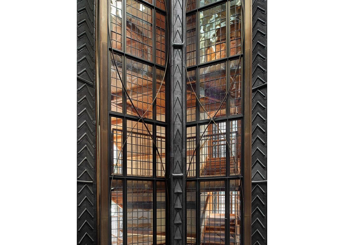 Steel held in tension accounts for the fineness of the seven-storey glass screen.