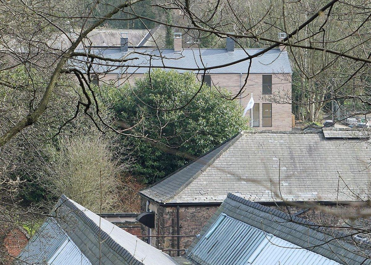 Seen across the still-active mill complex