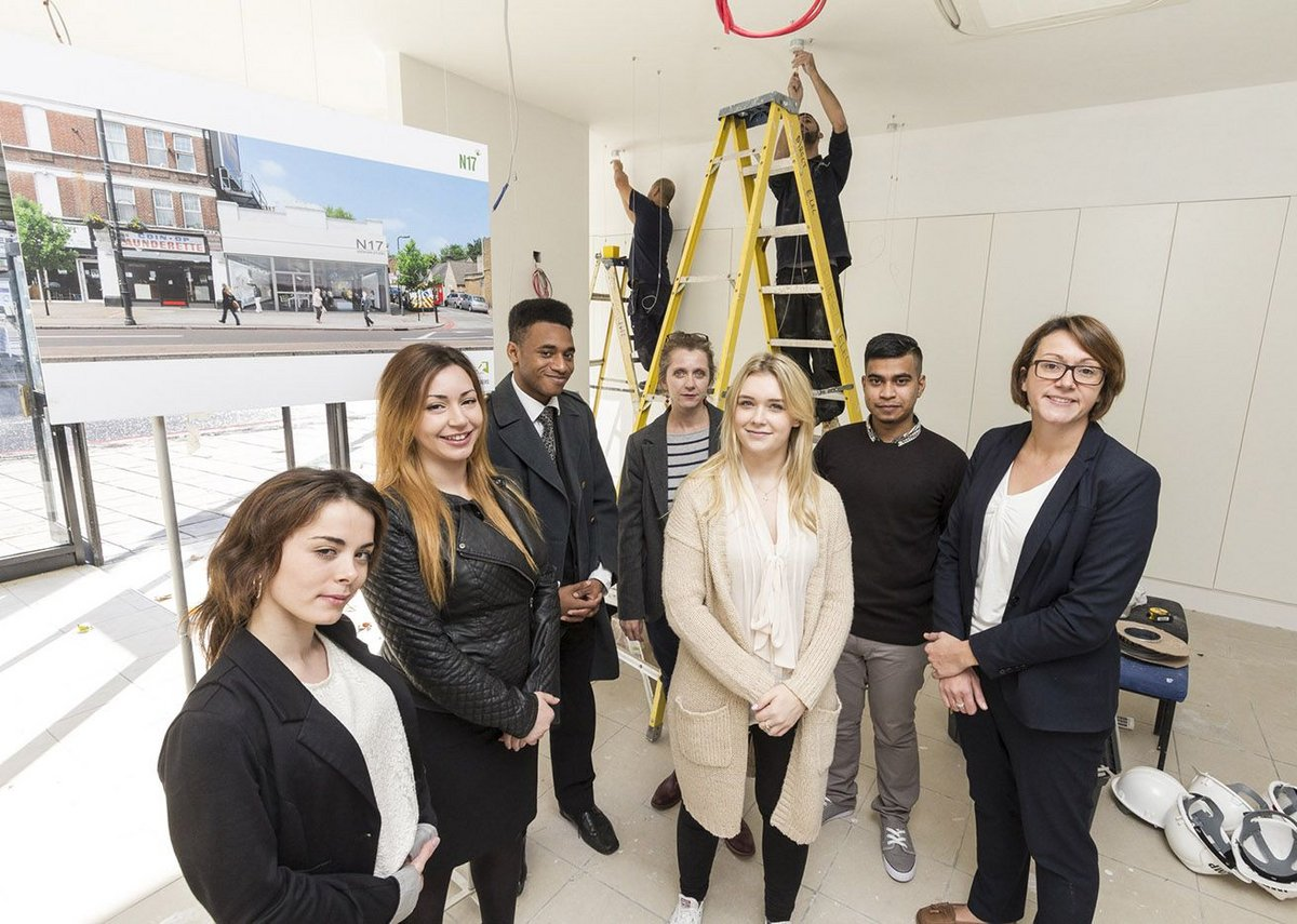 JMP apprentices Daisy Ignatiou, Zehra Harrison, Rhasan Brunner, Sam Ray and Akbar Hossain with (centre back) JMP's Natasha Manzaroli and (right) council leader Claire Kober