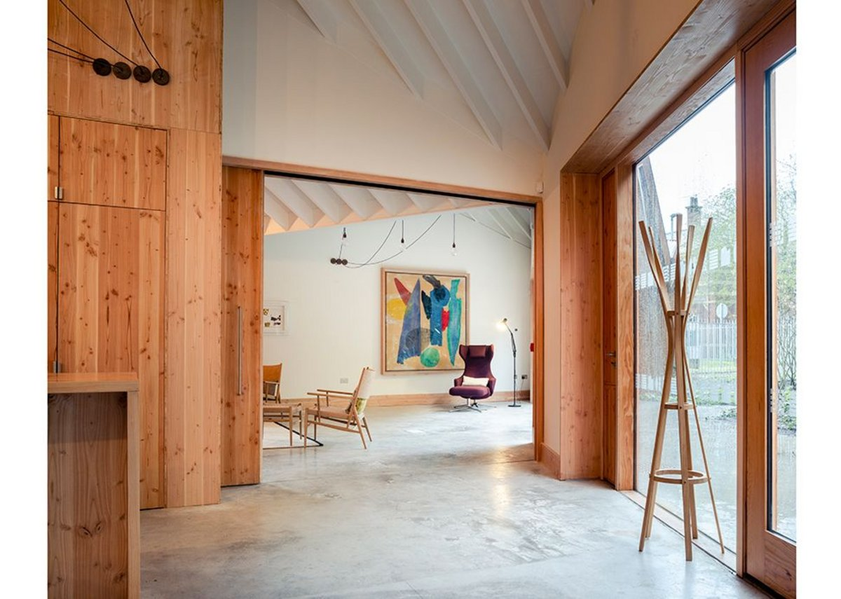 A sliding door means the studio space can be opened up to add to the main space or closed for yoga or art activities.