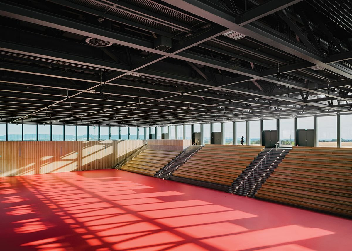 Bleacher seating suggests a directionality to the space that is neither explained nor justified.