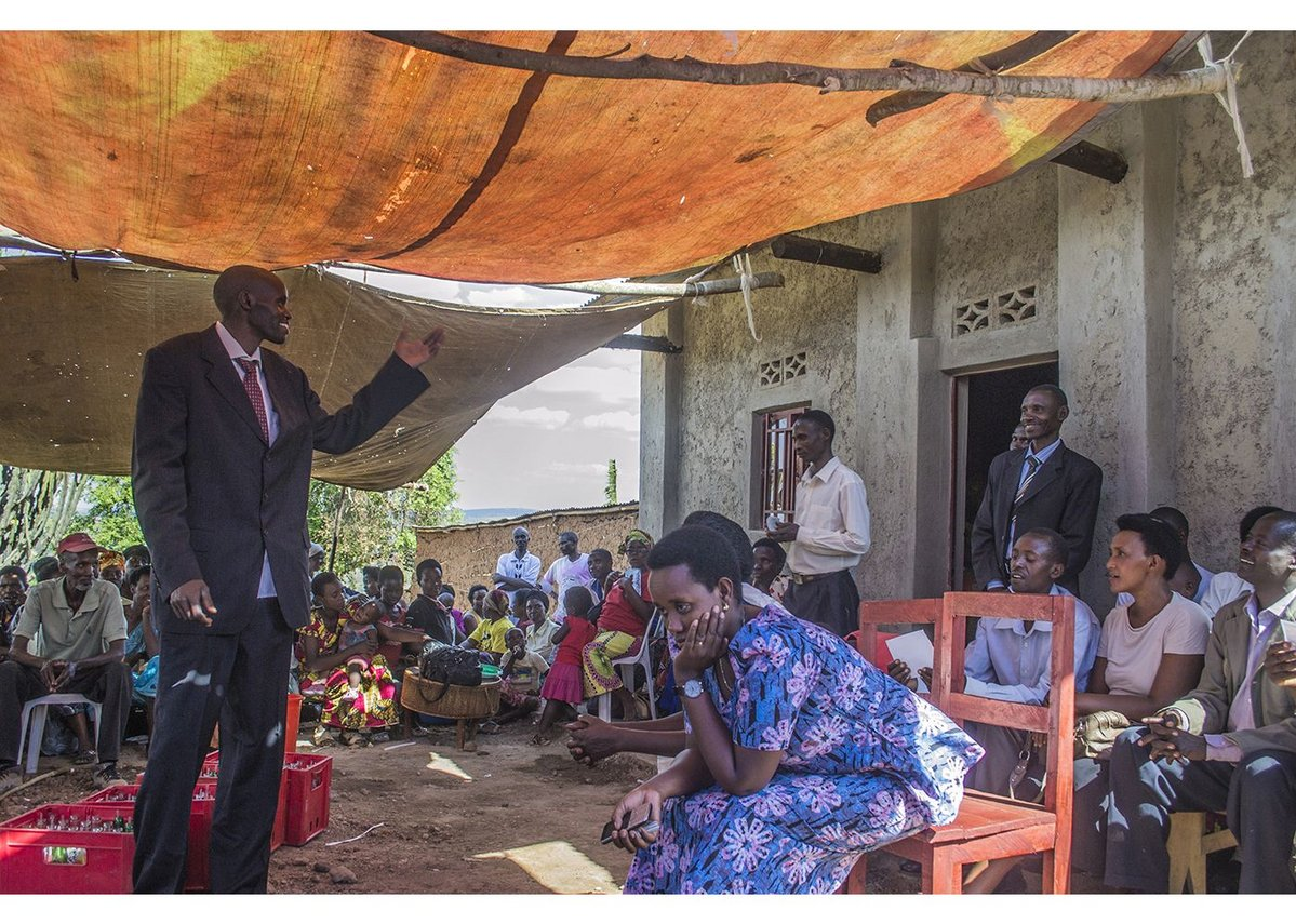 The beneficiary, Rutaganda, thanks the cooperative and welcomes them into his new house, Ntarama, Rwanda, August 2015.