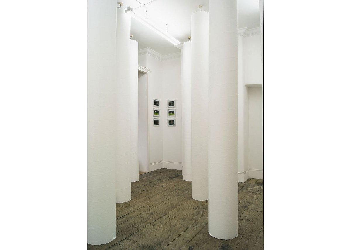 Installation view through columns within the Jacques Hondelatte exhibition at Betts Project gallery.