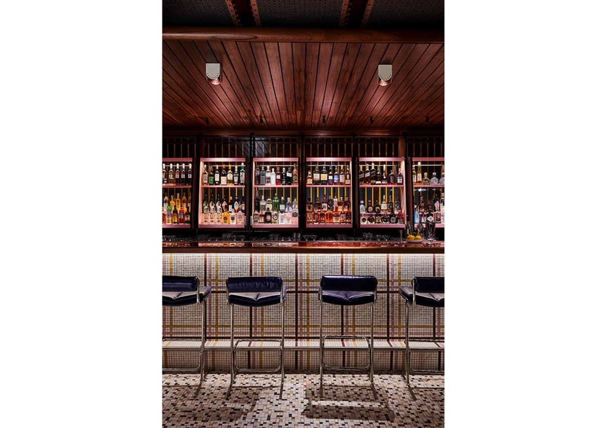 Timber and tile mosaic complete the bar's 50s look.