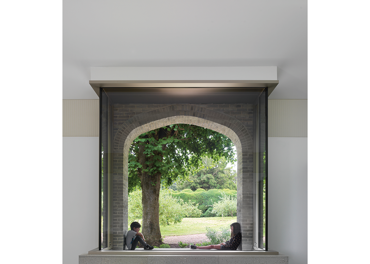 The learning centre's vitrine window sits under an arch reminiscent of those at the castle.