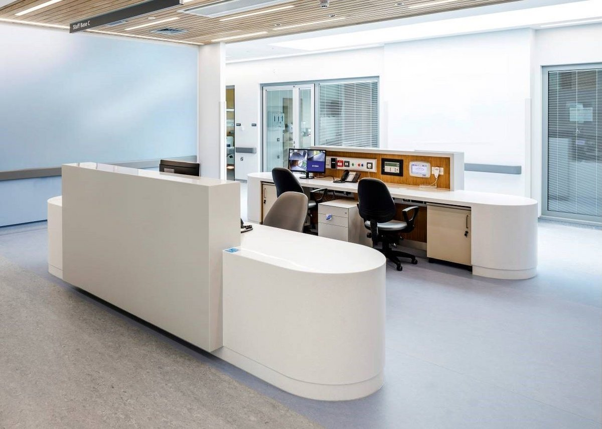 HI-MACS solid surface desks bring organic curves to Omagh Hospital's reception areas. The material is almost as robust as stone and can be sawn, routed, drilled or sanded.