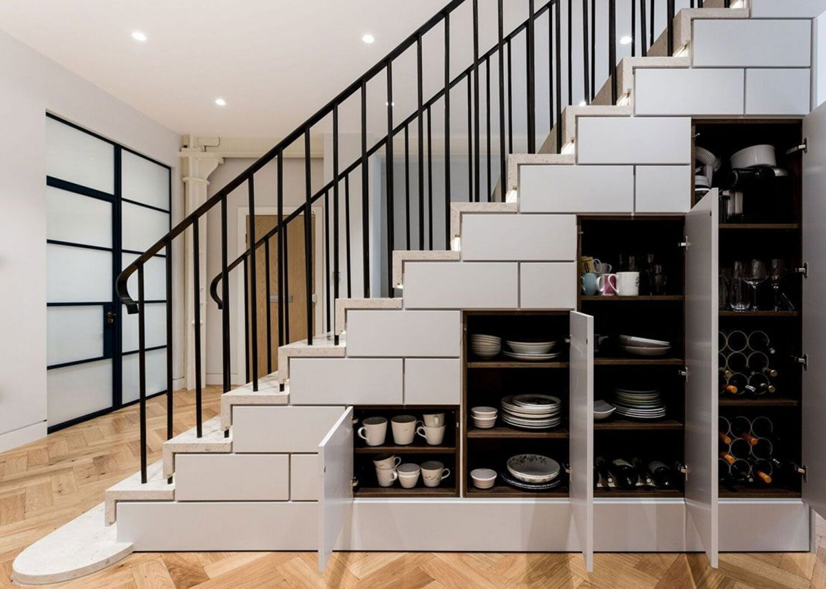 Roundhouse bespoke under-stair kitchen storage designed for a project by Simon Whitehead Architects.