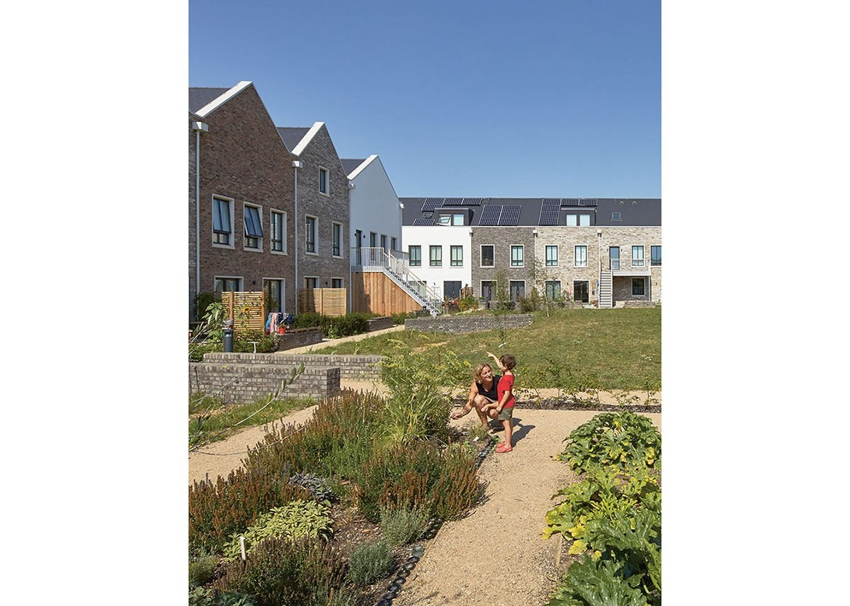 A shared garden offers space for play and growing plants.