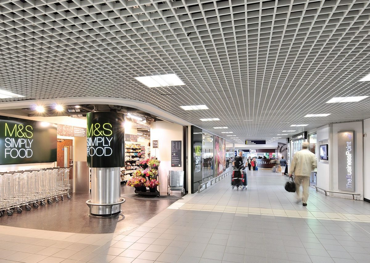 Armstrong open cell Cellio metal ceiling tiles at Birmingham Airport.