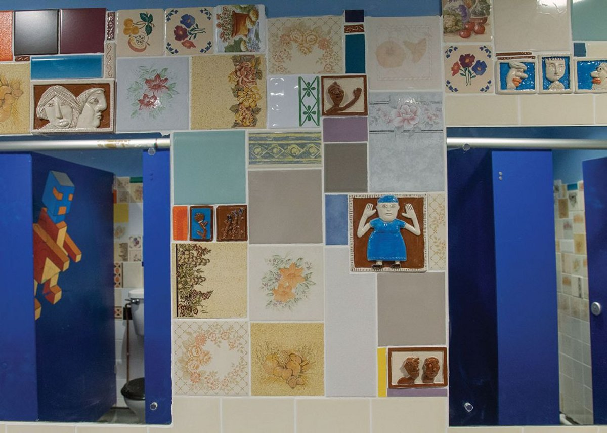 Donated tiles in the washrooms create beauty from contingency.