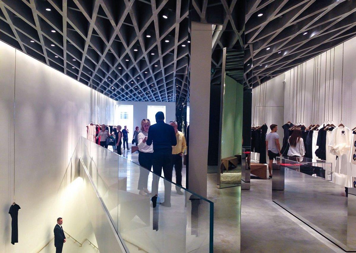The complex cross-hatched diagonals of an aluminium, concrete-clad fin ceiling is the pièce de résistance.