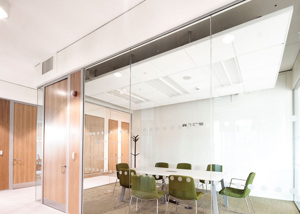 Chicago Metallic Infinity framed ceiling islands, installed with Rockfon Blanka E ceiling tiles, help create a modern design for the  Glucksman Library conference rooms.
