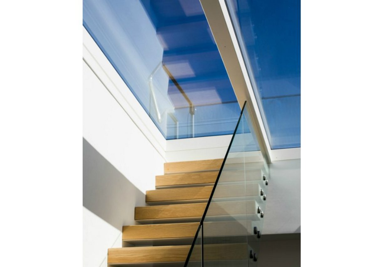 Glazing Vision's Sliding Over Fixed rooflight over the central stairway: A sliding pane retracts over a fixed one to open up access to the roof.