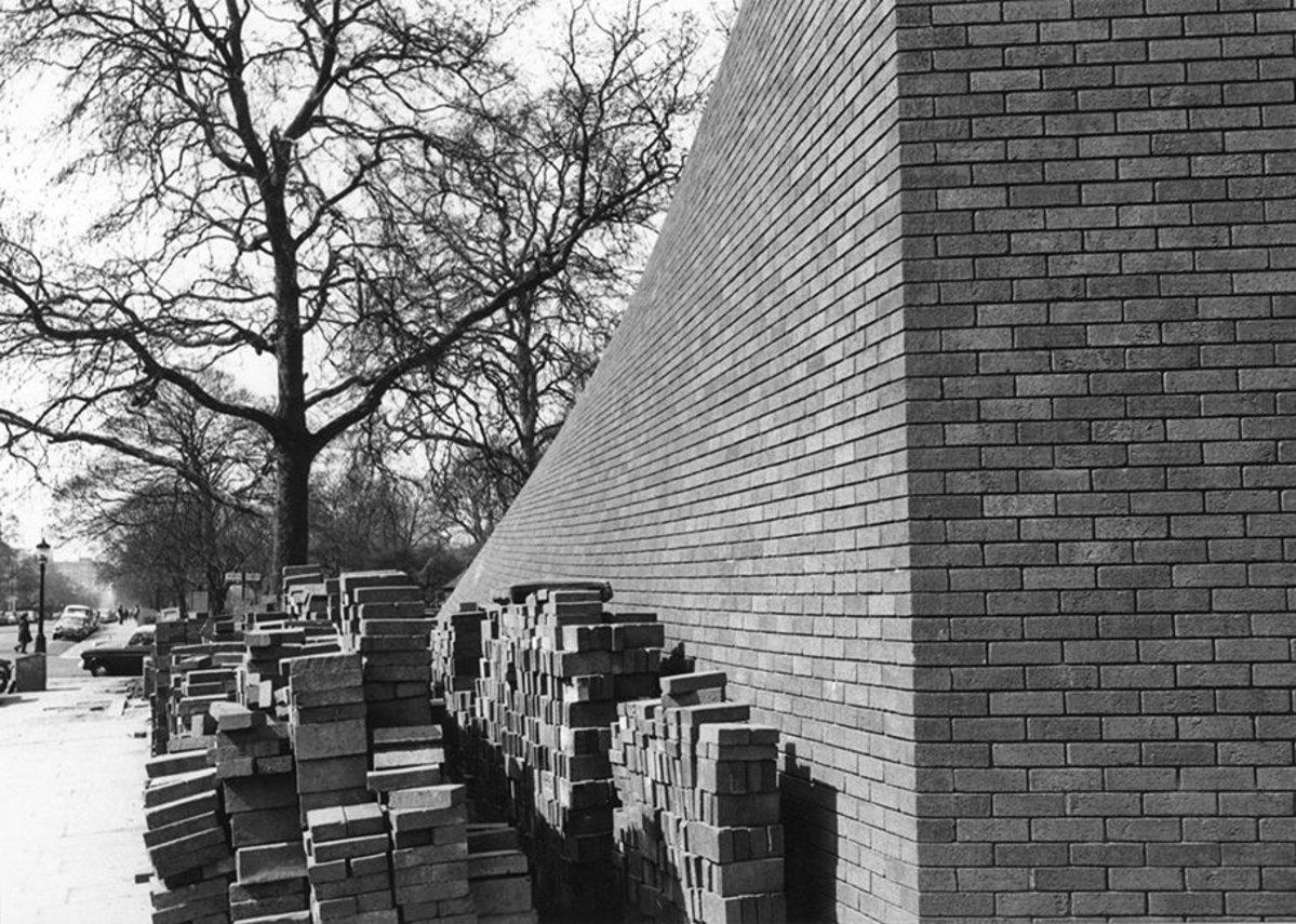RCP construction works   The Wolfson Theatre was a huge engineering challenge for Lasdun's team. It was designed with twists in its walls to align the building with Regent's Park and the awkward angle of St Andrews Place.   37 different types of Baggeridge blue engineering bricks were needed to create this effect. Because cut surfaces of bricks have a different texture and colour to fired surfaces, these special bricks had to be hand-cut before they were fired.   Many were rejected as being the wrong texture or colour, and were carried away by Edward Cullinan, a young architect in Lasdun's office. They were used to pave the floors of his homes in Camden and the North Staffordshire Moors.