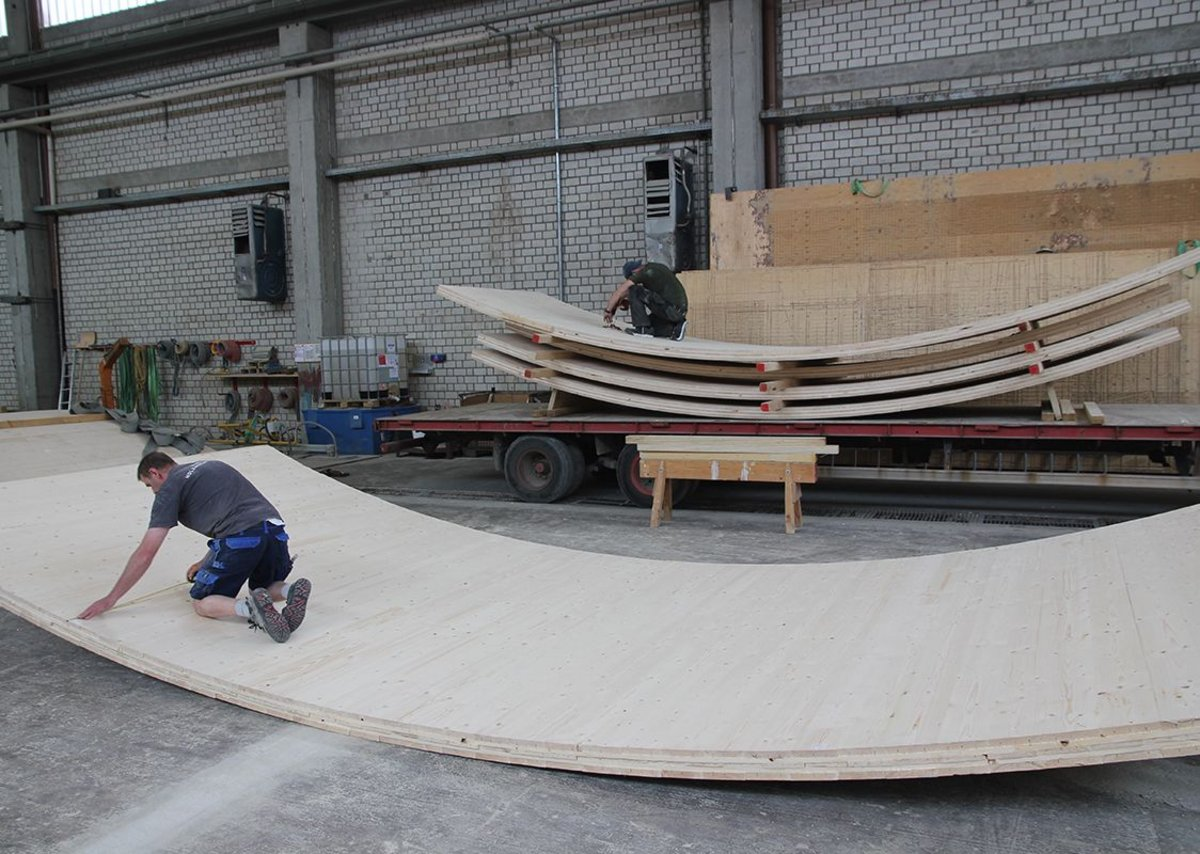 At the Merk factory as timber panels are fabricated and bent into shape.