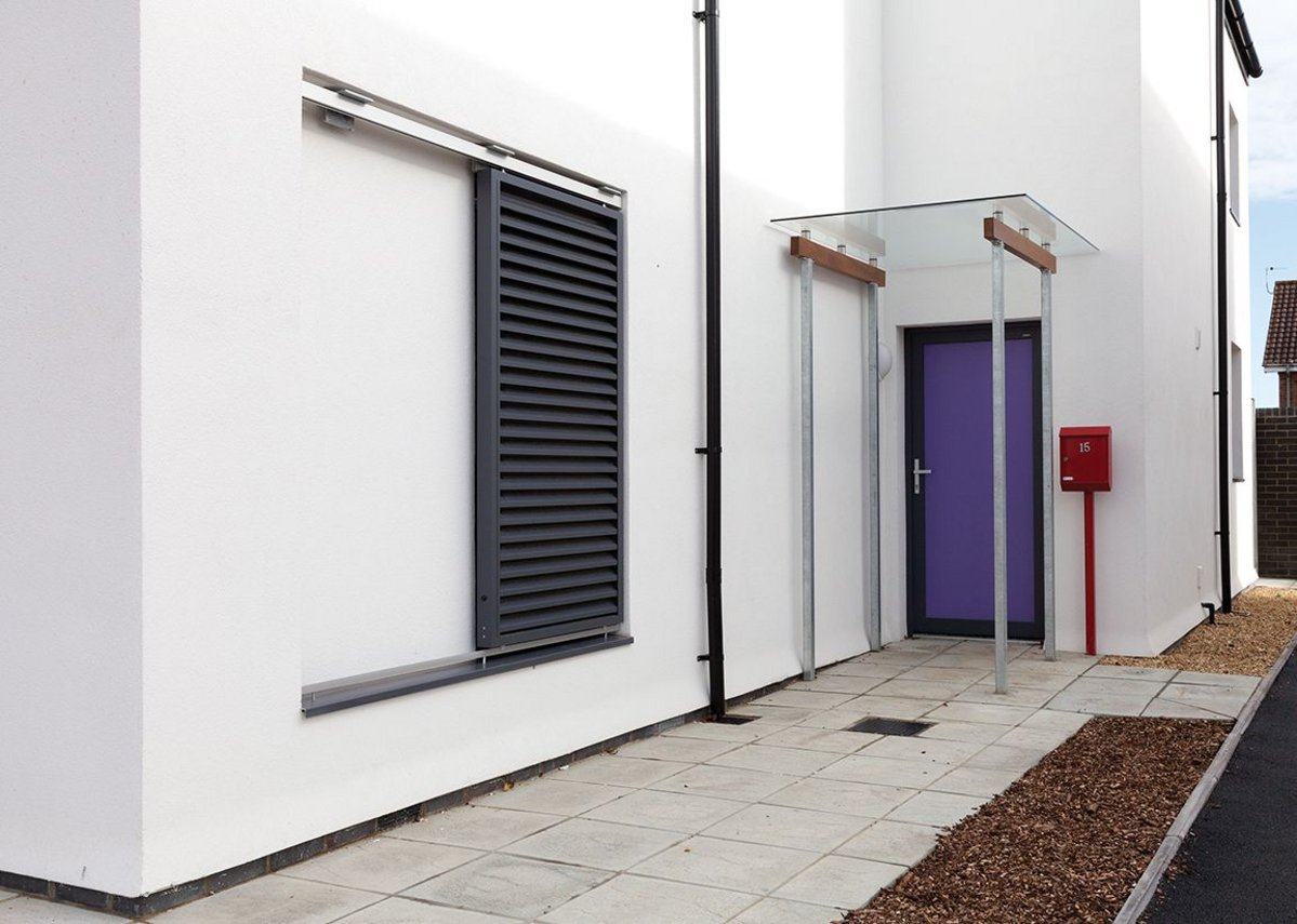 The homes feature insulating shutters on south facing elevations to minimise overheating.