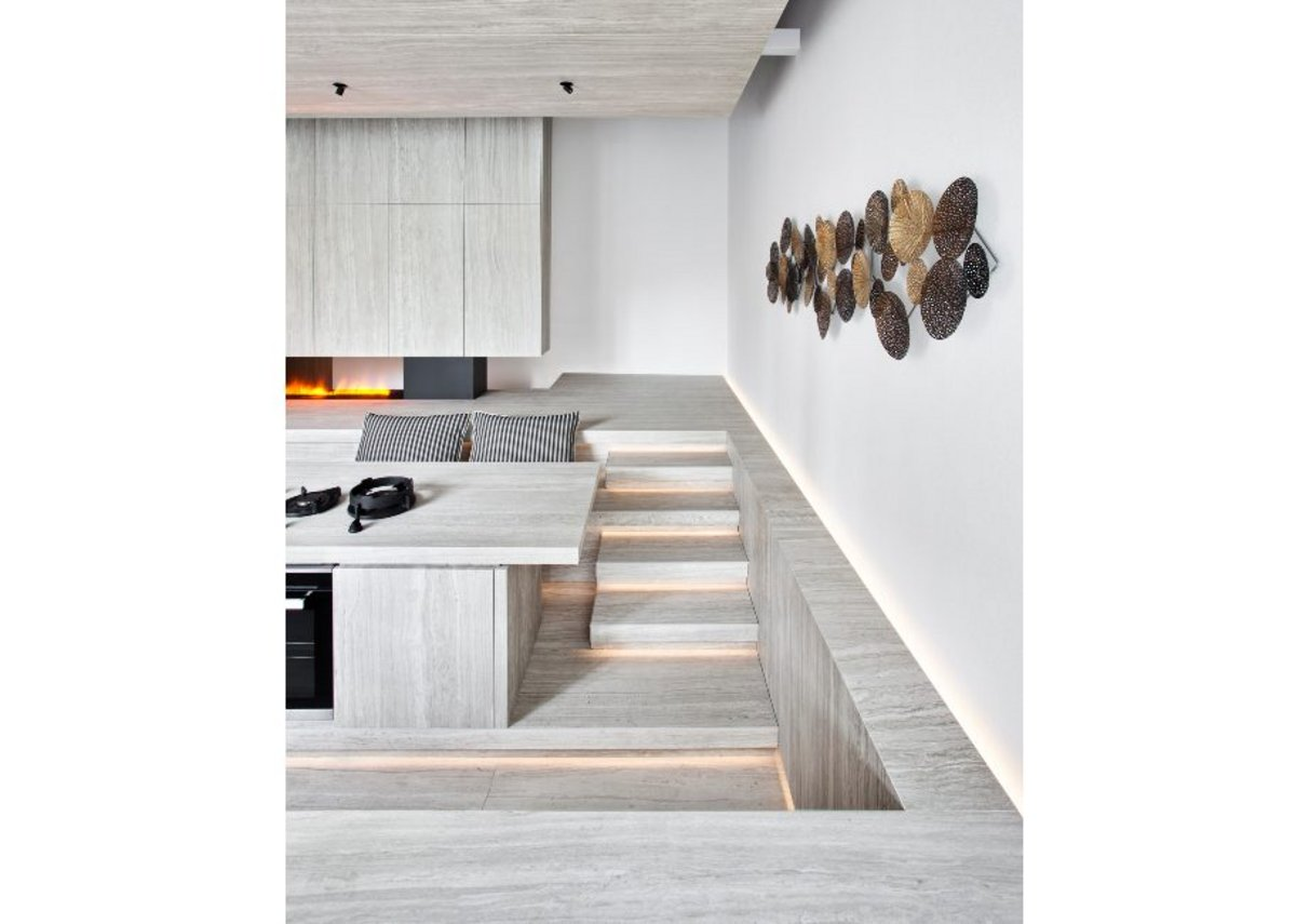 Neolith Strata Argentum surface material on floors, countertops, walls and ceilings in the Atrium area.