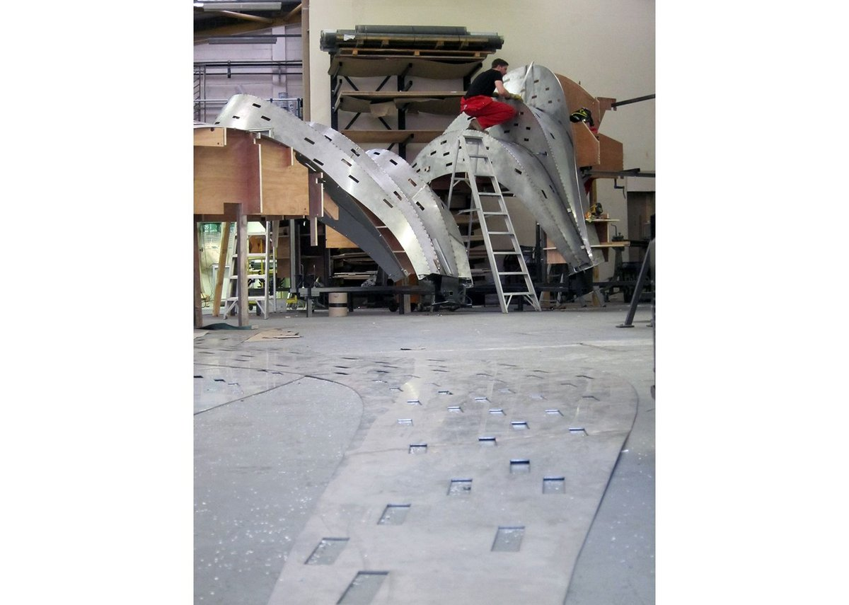 Assembling the now award winning Rain Bow Gate from 3mm thick stainless steel plates. Tonkin Liu