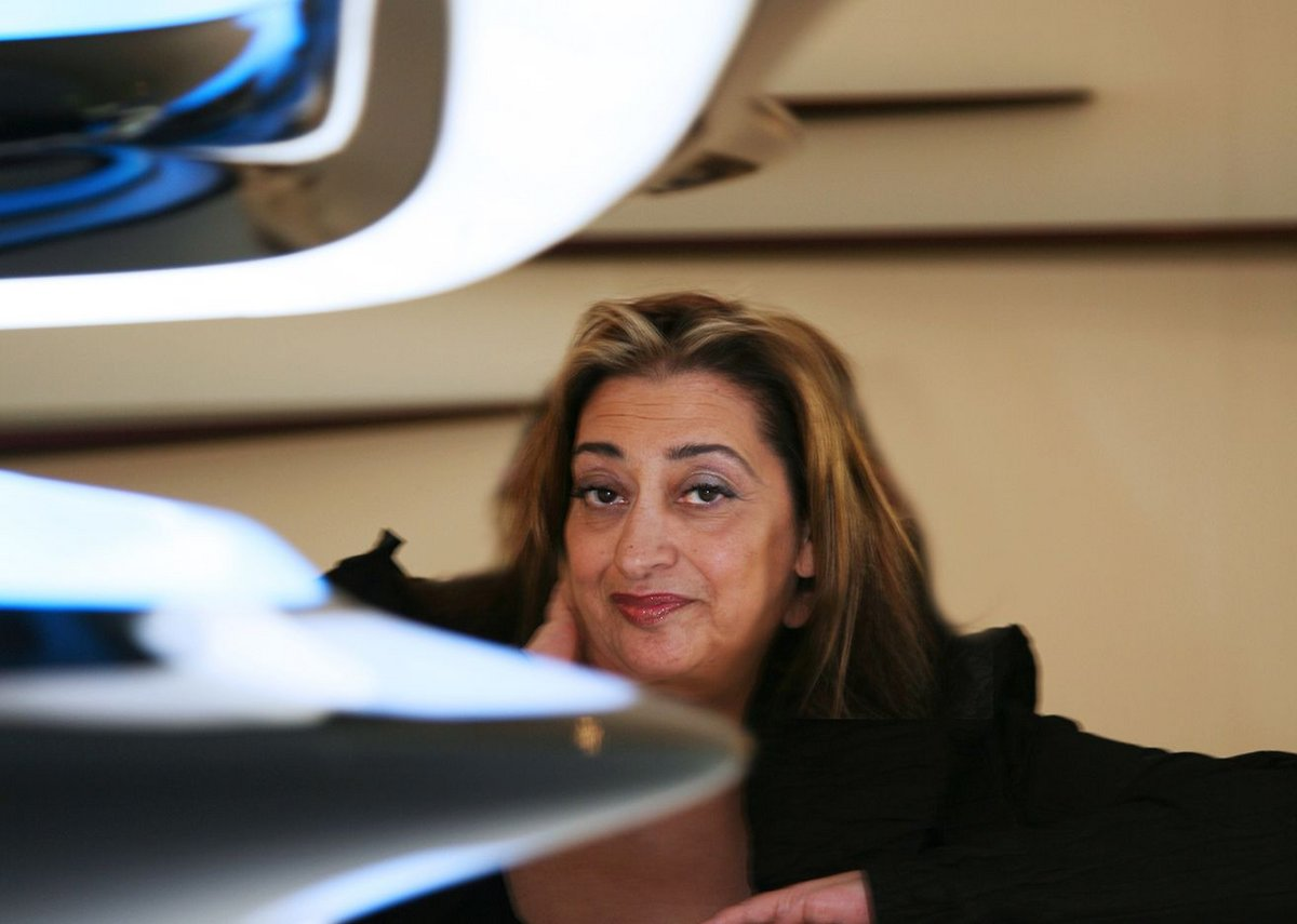 Zaha Hadid posed with furniture in black.