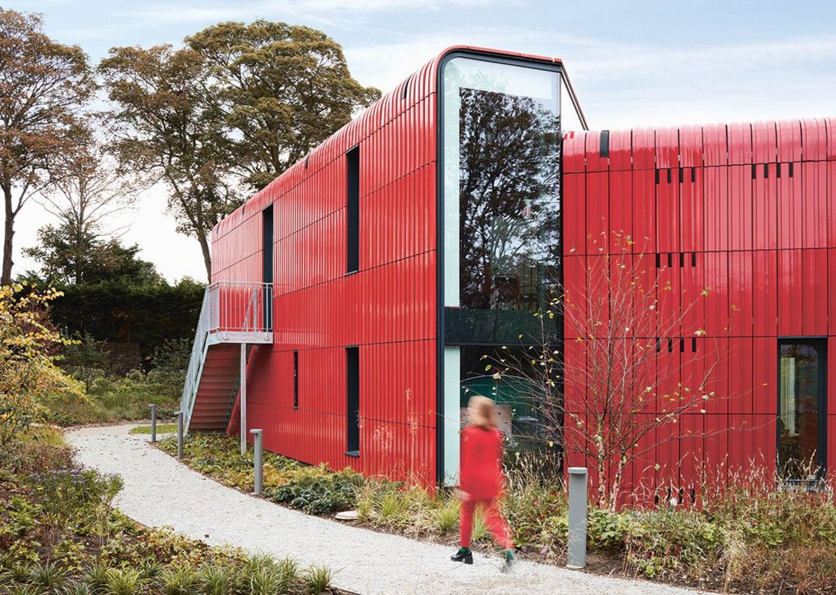 The building's north face offers more enclosed, views from within its red terracotta cladding.