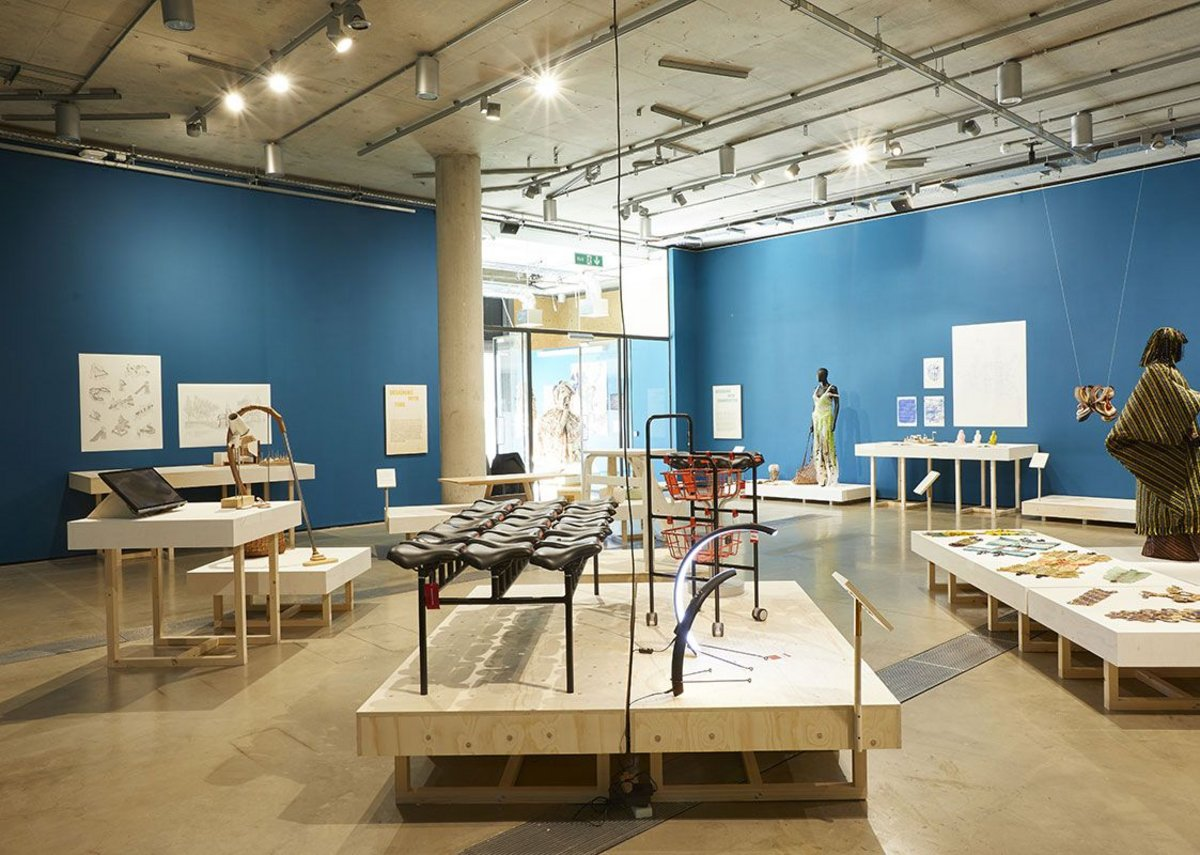 Installation shot of Designing in Turbulent Times, showing Qiang Huang's Bike Scavengers furniture in the foreground.