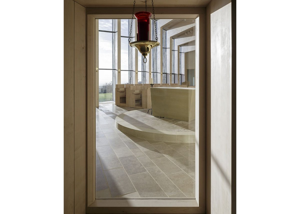 View through internal window through church from Chapel of Blessed Sacrament.