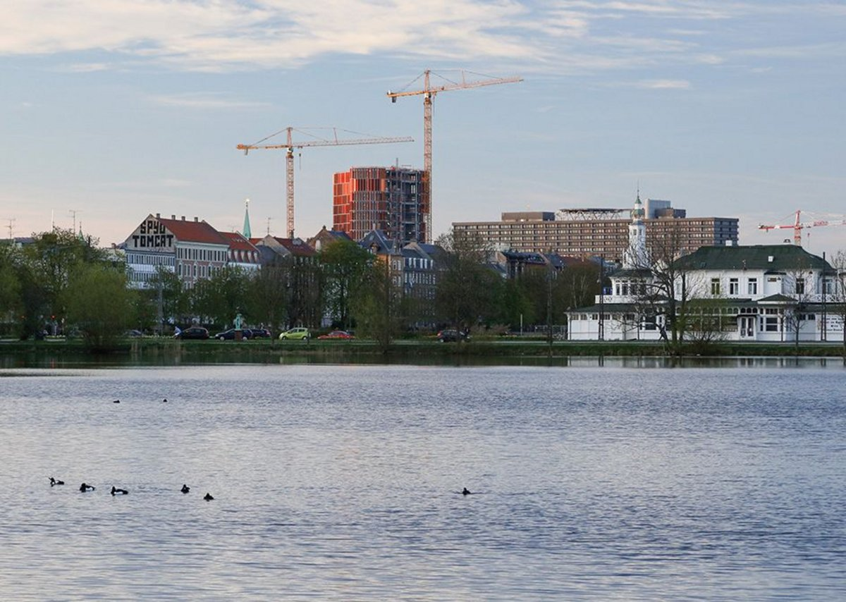 The Panum complex rising above the general level of the city, as seen from the city-side shores of the Søerne.