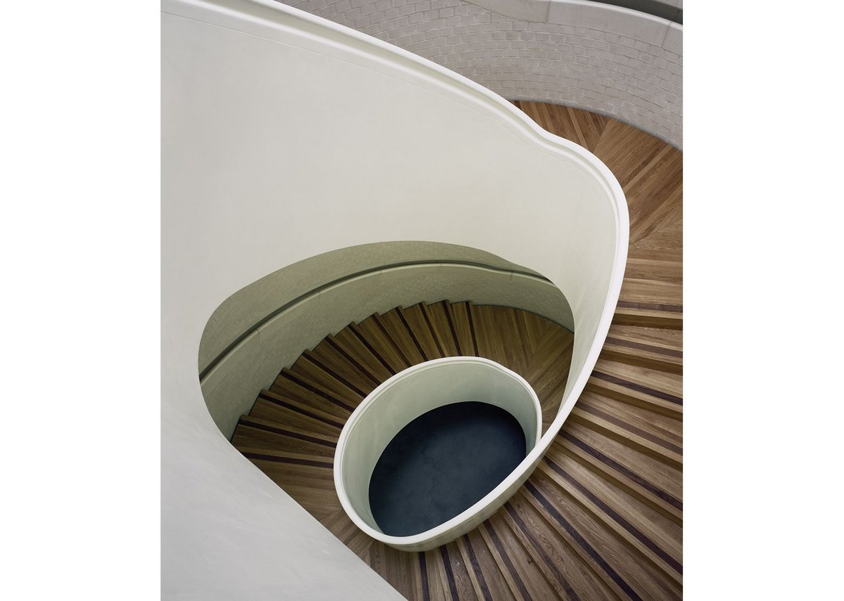 Digitally engineered, the brick, concrete and oak stairwell is, in itself, a technical marvel.