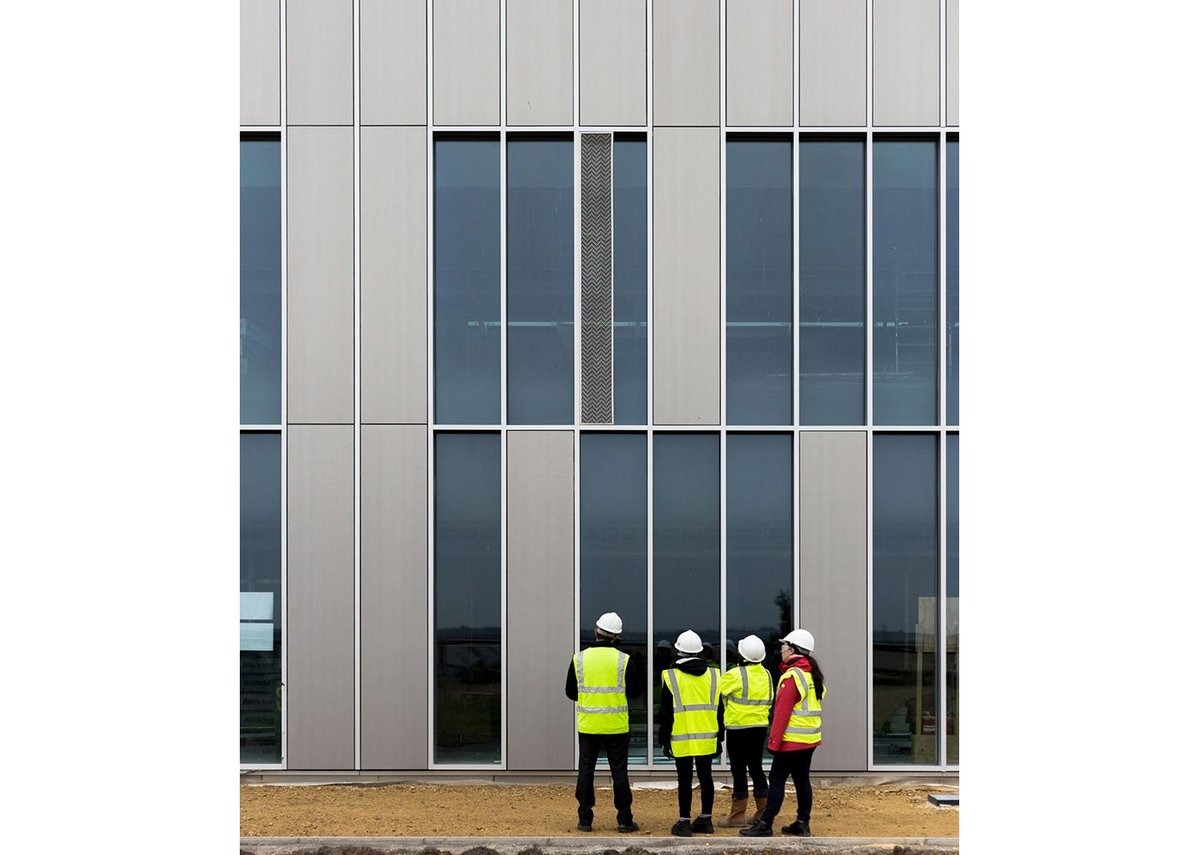 Baxter on site at the CEF office project in Durham, inspecting the porcelain cladding.