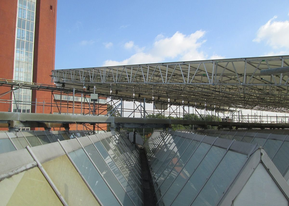 The original glass roof, with its thin aluminium sections, being prepared for the remediation works.