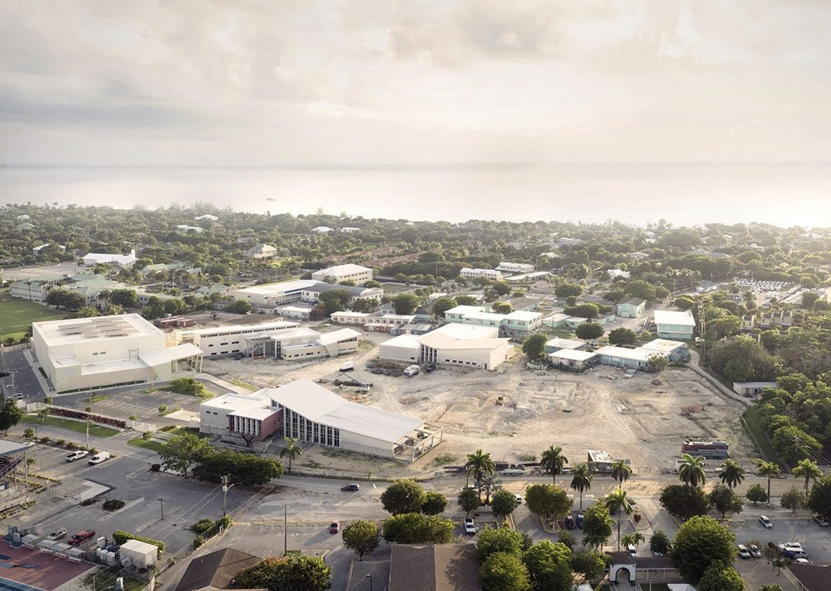 John Gray High School, Grand Cayman.  Before and after – the abandoned shell buildings are repurposed in and connected in the completed high school.