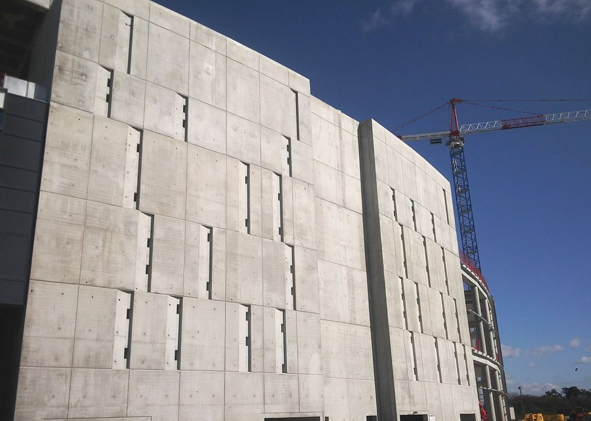 The massive concrete walls are the result of French guidance on fire egress and seismic considerations.