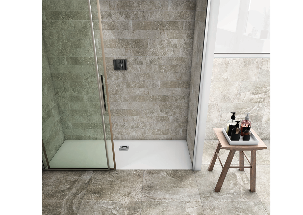 Elegant RAK-Feeling matt finish shower trays are tactile and provide enhanced anti-slip safety. Stone-effect tiles give a distinctive feel to the shower area.