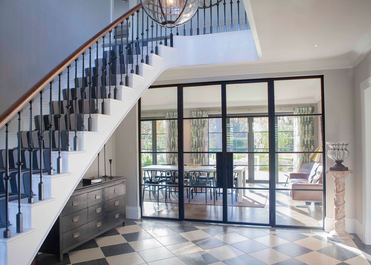 Architectural Bronze Casements' internal bronze screen separates hallway from kitchen in a new-build project. Andrew Davison Architects.