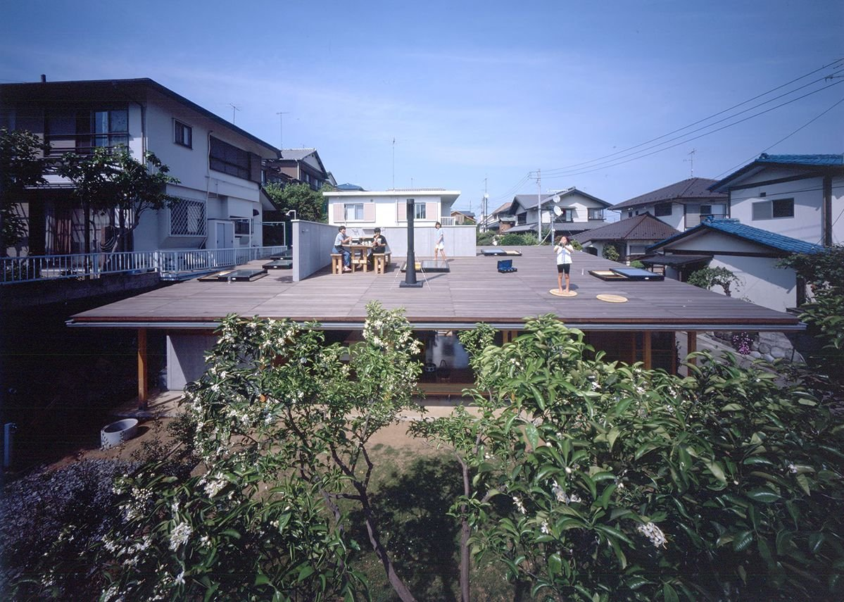 Roof House in Hadano, Kanagawa, 2001, designed byTezuka Architects (Takaharu + Yui Tezuka). The roof is accessed by ladders from the ground floor and functions as the house's primary space.