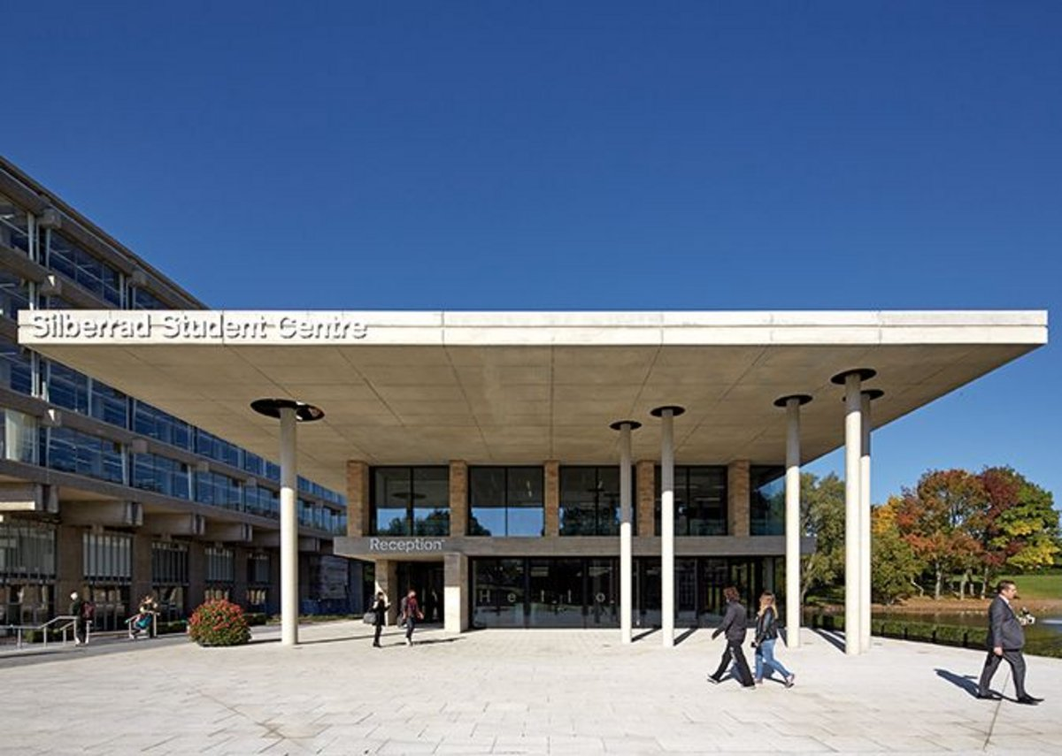 The huge concrete roof overhang of the student centre creates an exterior formal room for university functions.