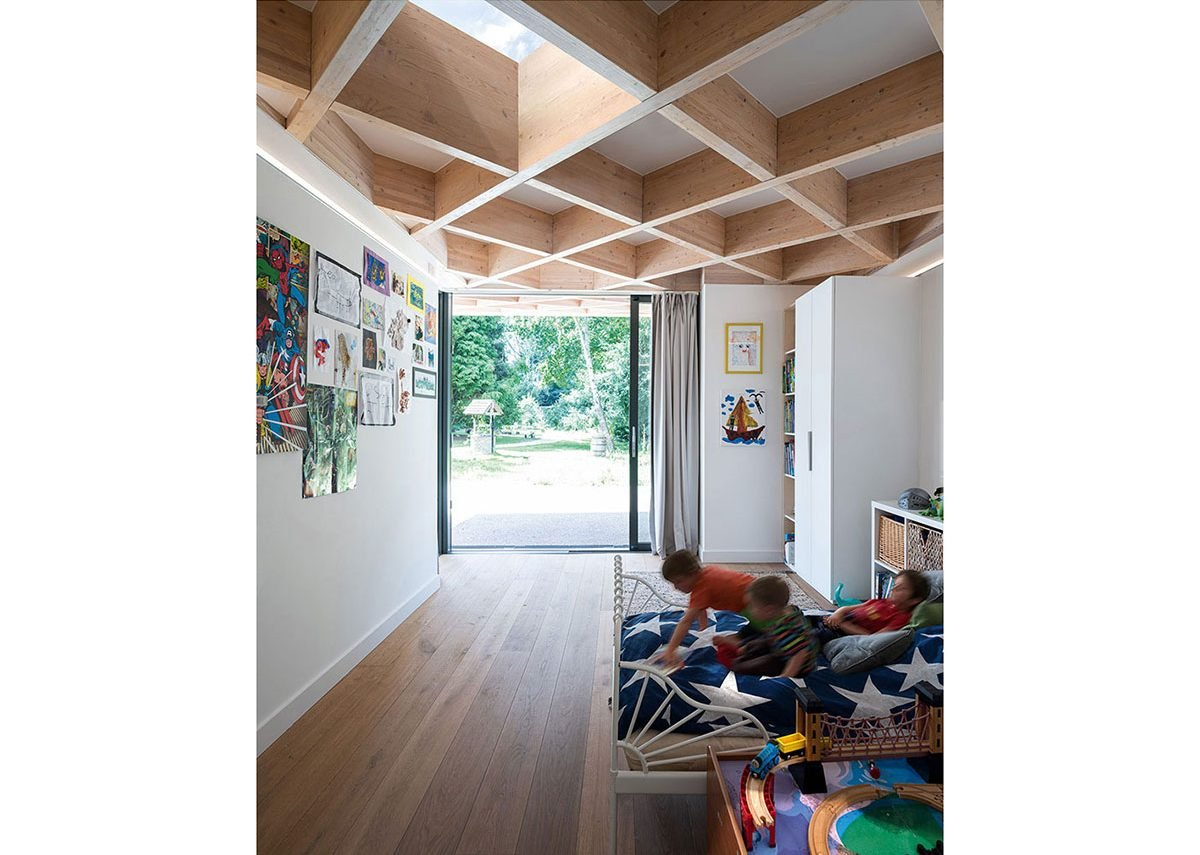 A wide accessible rear entrance gives direct access from the children's rooms to the covered play spaces and garden.