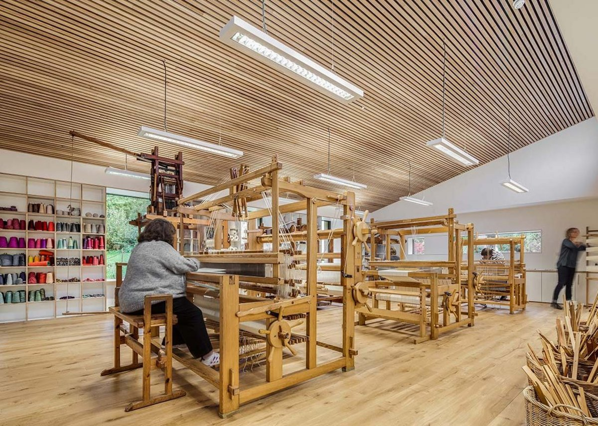 Concentrated meaningful work in this warmly timbered weaving workshop.
